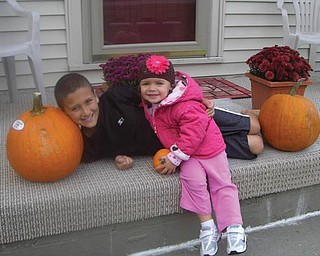 Rowen and Maria Clark enjoyed posing their children around their fall decorations at their home in Campbell. Alexa is 2 1/2 and Ross is 9.