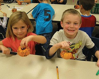 Landry Naples and Nicholas Brown were among the kindergarten students in Katie Gallagher's class at Ellsworth Elementary School who decorated pumpkins, courtesy of the Green Team.