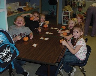 Students in Mrs.Carr's kindergarten class at Springfield Elementary School decorated pumpkins.