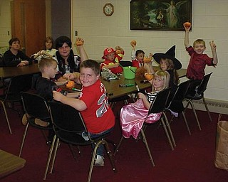 Students decorated pumpkins during their Halloween party at Sebring Trinity Lutheran Church.