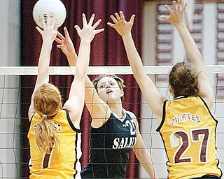 The Vindicator/Geoffrey Hauschild Salem's Amy Scullion hits the ball past Southeast's Emily Gahagan (7) and Kelsey Tuttle(27) at Boardman High School on Tuesday evening.