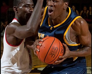 The Vindicator/Geoffrey HauschildYSU's Sirlester Martin (5)defends Kent State's Anthondy Simpson (21) during the first half at Beeghly Center on Wednesday afternoon.
