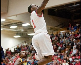The Vindicator/Geoffrey HauschildYSU's DeAndre Mays soars toward the basket scoring two points for the Penguins during the first half at Beeghly Center on Wednesday afternoon.