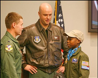 The Vindicator/Robert K. Yosay -----Meeting the colonel  -  Alan Hinton 11 of Youngstown  talks over strategery with Colonel Craig Peters and Capt Brian Hodor ( the pilot of the C-130 and Alans Mentor ) - Alan was pilot for a day at the Youngstown Airbase - 11182009