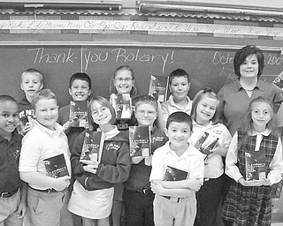 Special to The Vindicator new books: How do you spell t-h-a-n-k y-o-u? Students in Mrs. Kelly Kroynovich's third-grade class at St. Patrick School in Hubbard will know how thanks to the Hubbard Rotary Club. Each year the club presents children in the new third-grade class with new dictionaries for them to keep so they can excel in their schoolwork.