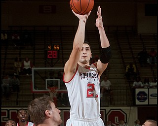 The Vindicator/Geoffrey Hauschild YSU's Zack Rebillot completes a two point shot during the first half of a game against Geneva at Beeghley Center on Tuesday evening. 11.24.2009