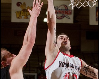 The Vindicator/Geoffrey Hauschild YSU's Dallas Blocker unsuccessfully goes up for a layup while defended by Geneva's Matt Blocki during the first half of the game at Beeghley Center on Tuesday evening. 11.24.2009