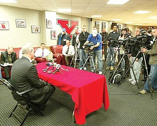 MEETS THE PRESS: Ron Strollo, YSU's athletic director, talks to reporters after Jon Heacock's resignation as football coach. Strollo said Monday he is immediately launching a national search for a successor.