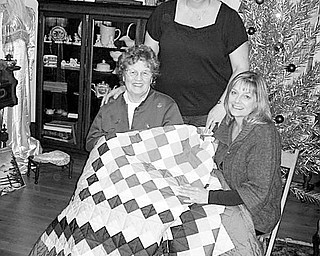Special to the Vindicator JUST THE TICKET: Members of Hubbard Historical Society sold raffle tickets for an Amish quilt to raise funds for the maintenance of the historic McBride House, 27 Hager St. Admiring the quilt is Donna Jean Cargill Ragozzine, seated at right, who held the winning ticket and received the quilt. Sharing the happy moment are, seated at left, her mother, Mary Jane Harbison, and standing, her sister-in-law, Sherry A. Cargill.