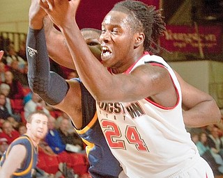 YSU's Eddie D'Haiti (24) recovers a rebound during the first half at Beeghly Center on Wednesday afternoon.