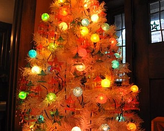 This Christmas tree at the Arms Family Museum is decorated with toys from TinkleToy Company, a division of Youngstown-based Plakie Toys, Inc. (The toys spin with the heat of the lights in the tree.)