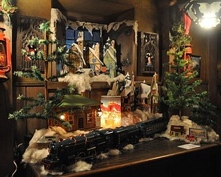 The Arms Family Museum of Local History's reception room, decorated for Christmas with a 1940s model train.
