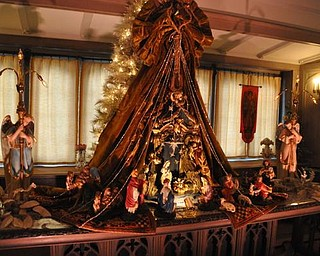 The Arms Family Museum's Library, decorated for Christmas. This nativity set is Italian papier mache.