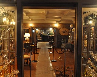 A view of The Arms Family Museum's Library, decorated for Christmas, from the solarium.