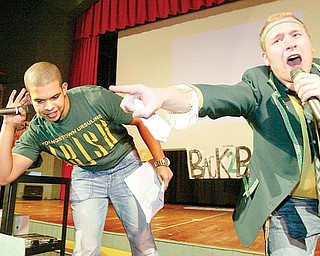 URSULINE RALLY: Steven Bernard, left, and Louis Isabella, Ursuline High School senior, serve as masters of ceremonies at the school's pep rally in preparation for the Fighting Irish's state championship game against Coldwater today in Canton. The rally was Thursday.