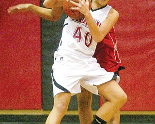 William D. Lewis/The Vindicator Desiree DeFrank of Girard tries to keep the ball from fitch's Erica Braxton during Thursday action at Girard.