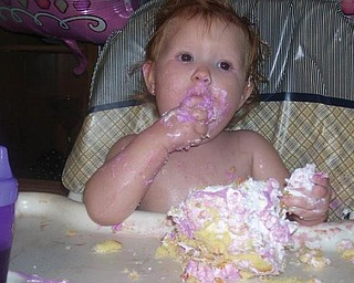 A PIECE OF CAKE! Chelsea Lynn Campbell of Youngstown celebrated her first birthday on Oct. 10. Looks like she really enjoyed it!