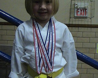 Julianna Hornikel of Girard won three medals in her very first karate tournament.