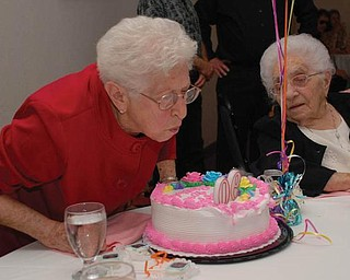 BIG DAY: Gilda Zavodni from New Middletown celebrated her 90th birthday on April 7. Looking on is her sister from Canfield,who will celebrate her 100th birthday this coming August.