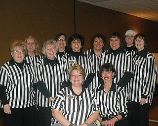 'Official ' greeters at the March, 2009, annual college scholarship fund raiser sponsored by the Yo-Mah-O Chapter of IAAP were, front from left,  Chris Simone and Laura Malloy, and, back from left, Chris Bidwell, Lynn Romeo, Andrea McConnaughy, Tracy Goad, Milissa Ferraro-Gahagen, Nancy Brunner, Joyce Laska, Kim Sheward and Marlene Dailey.