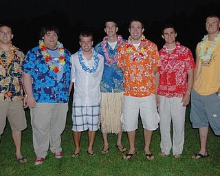 Friends and family did not let the tough economic time prevent them from returning to their hometown from all over the country to celebrate the wedding of Ryan and Megan Maxwell. Seen in this picture at the rehearsal dinner luau, from left, are Russell Dawson of Florida, Steve Safran of South Carolina) David Maxwell of North Lima, Joe Rettig of Dayton, Ryan Maxwell of Kent, Danny McCooey of Texas and Alex Duncan of East Palestine.