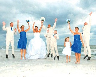 JUMPING FOR JOY: Celebrating the wedding of Wendi and Rob Spatar on Oct. 17 at Longboat Key, Fla., are, from left, Jeff Spatar of Howland, Juli Barnes of Girard, Wendi and Rob of Boardman, and Justin, Taylor, Sherrie and Anthony Spatar, all of Canfield.