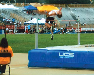 Aaron Hartsough set Canfield High School's record with a jump of 6 feet 41?2 inches.