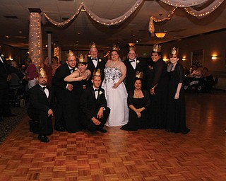 Lisa and Mike Kuty say 2009 was a great year ? they got married. Kneeling, from left, are Ken Payne of Austintown, Ted Oltmann of Hubbard and Lyn Stewart of Warren. Standing, from left, are Nick Dominick of Struthers, Julie Dominick of Struthers, Mike and Lisa of Girard, Bill Sicafuse of M Murray, Pa., Amanda Brewer of Hubbard and Theresa Honaker of Girard.