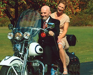 Tom and Chris Christmas were joined by friends and family, all of whom were riding their motorcycles to the wedding reception on Oct. 10.