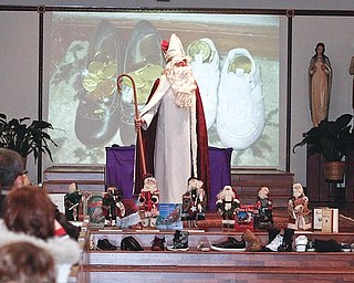 CENTER STAGE: The legendary St. Nicholas of Myra appears at St. Nicholas Church in Struthers. Sunday's service included prayer, songs, the filling of the shoes and the story of the candy cane.