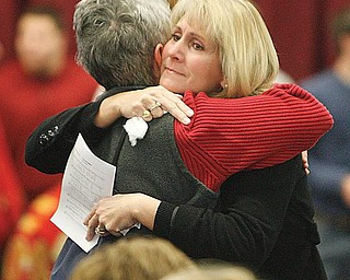 """Condolences and hugs as the """"Mooney Family"""" had a mass at the school to deal with the deaths of two seniors over the weekend."""