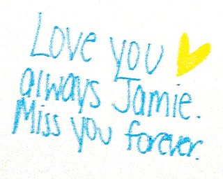 MISS YOU:  A message on a poster board for Jamie Serich at the memorial mass Monday. Mourners were asked to write messages and express their feelings on the  boards,  on display at the back of the chapel in Cardinal Mooney High School.