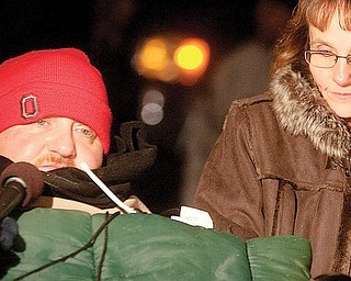Joe Kaluza is interviewed by a television reporter alongside his sister, Anna Fitzgerald, during a Christmas lighting ceremony at the newly constructed home on Monday evening.
