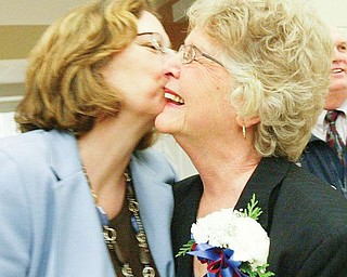 SAYING GOODBYE: Joyce Pogany, right, shares an embrace with her daughter, Pam Gent, at a reception to celebrate Pogany's retirement after 28 years on the Austintown school board. Pogany was honored by family, friends and colleagues at a party before her final board meeting Monday.