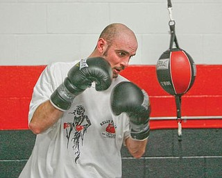 FOCUSED: Kelly Pavlik, shown here working out at the South Side Boxing Club in January, will hold an open workout at the gym today in preparation for his Dec. 19 bout at YSU.