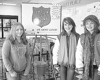 Special to The Vindicator CHRISTMAS SPIRIT: On Dec. 5 Fitch Interact Club members helped collect funds for the local Salvation Army Christmas appeal. This is a project that has been going on for the past 15 years, and members look forward to helping this worthy cause. Among those who helped were, left to right, Michelle O'Connor, Katie Fabrizio and Olivia Lanterman. Others who collected for the cause, but not pictured, were Devlin Geroski, Summer Tarr, John Phan, Sylvia Smulski, Sara Pretoka, Nicole Venorsky, Elan Caruso, Angela Murphy, Gina Cheff, Kara Mort, Leslie Weaver, Alex Sofranko, Megan Tirabassi, April Krempasky, Ashley Krempasky, Zarek Bell, Sara Guittar, Brandon Rivello and advisers Tina Kubacki and Gary Reel.