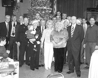 Special to The Vindicator FOR THE CHILDREN: Youngstown Lions Club recently hosted its 89th consecutive Christmas party for the visually impaired and special needs children from Youngstown schools. The youngsters were treated to a turkey luncheon and Christmas carols. Santa Claus was on hand to distribute 120 gifts, which were requested by the children and provided by the Lions. The children also received scarves and gloves purchased with funds donated by RE/MAX Valley Real Estate. Special guests included Wendy Webb, superintendent of the Youngstown City Schools; teachers; mentors; and a guest who has attended the party each year for more than 70 years. In addition to hosting the party, the Lions Club raised funds at an annual Turtle Derby and provided more than $20,000 this past year for those in need.