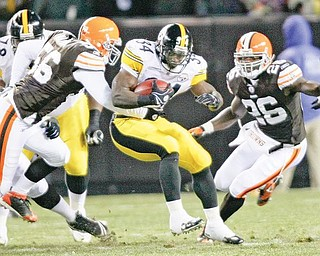 Pittsburgh Steelers running back Rashard Mendenhall, center, runs for four yards against Cleveland Browns linebacker Kaluka Maiava (56) and safety Abram Elam, right, in the first quarter of an NFL football game Thursday, Dec. 10, 2009, in Cleveland. (AP Photo/Mark Duncan)