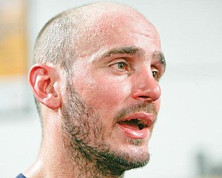 GETTING READY: Boxer Kelly Pavlik takes a break during a workout this week. The Youngstown 