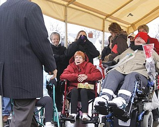 The Vindicator/Lisa-Ann Ishihara--Mayor Jay Williams approaches Lisa and Joe Kaluza. Sunday December 13, 2009