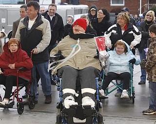 The Vindicator/Lisa-Ann Ishihara-- Lisa and Joe Kaluza  entering their new house. Sunday December 13, 2009