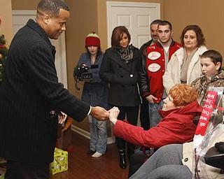 The Vindicator/Lisa-Ann Ishihara-- Mayor Jay Williams gives Lisa and Joe Kaluza keys to their new house. Sunday December 13, 2009