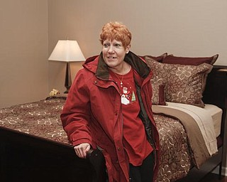 The Vindicator/Lisa-Ann Ishihara-- Lisa Kaluza  reacts to seeing her bedroom in their new house. Sunday December 13, 2009