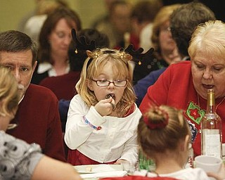 The Vindicator/Lisa-Ann Ishihara-- Rory Schuler (5) of Boardman takes a big bite during vilija (traditional Slovak Christmas Eve meal) at St. Matthias Church Father Snock Parish Center hosted by American Slovak Cultural Association Sunday December 13, 2009