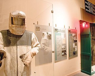ON DISPLAY: This exhibit at the Youngstown Historical Center of Industry & Labor on Wood Street showcases steel-working safety equipment. A changeover in management of the center, commonly known as the steel museum, was discussed Monday night.