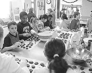 TASTY TREATS FOR TROOPS Special to The Vindicator GOOD COOKIES: Pupils in the fourth grade at St. Patrick School in Hubbard learned a valuable lesson in caring and sharing as they became involved in the Project Serving Soldiers led by Zack Lord of Hubbard, whose brother is serving in the Navy in Iraq. The goal of the project is to ship 300 dozen cookies to troops serving in foreign lands. The youngsters provided the ingredients and are pictured above as they spent part of a morning in the parish center making 15 dozen chocolate no-bake cookies for the troops. They worked on the project under the guidance of their teachers, Mrs. Sharisky and Mrs. Yambrovich, and volunteer parents. The pupils also sponsored a dress-down day and raised $145 to help pay the $10 shipping charge on each box of cookies.