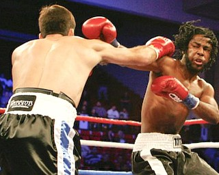 Campbell High graduate Christos Hazimihalis wins his pro debut at YSU's Beeghly Center Dec. 19, 2009 as part of the undercard for the Kelly Pavlik title fight.