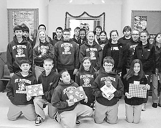 Special to The Vindicator GIFT GIVERS: The Builders Club of St. Patrick School in Hubbard was dedicated this season to bringing holiday cheer to students at the Rich Center for Autism, on the campus of Youngstown State University. Club members, above, hold some of the gifts they purchased with their own money while shopping after school hours. The 20 gifts were wrapped and delivered to the center. Made up of seventh- and eighth-grade students at the school, the club is committed to helping fellow students and community members through service projects.