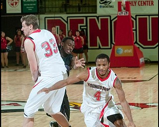 The Vindicator/Geoffrey HauschildYSU's Vance Cooksey (4) travels down court after teamate Dan Boudler (33) blocks High Point University's Tehran Cox (2) during the second half of a game at Beeghley Center on Tuesday evening.