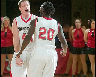 The Vindicator/Geoffrey HauschildYSU's Vytas Sulskis (44) and teamate Ashen Ward (20) bump chests in in celebration while leading by ten points during the second half of a game against High Point University at Beeghley Center on Tuesday evening.